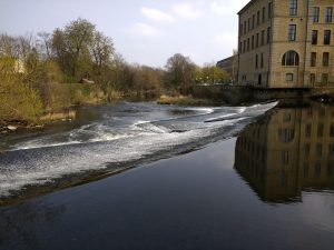 River Aire with weir near Salts Mill